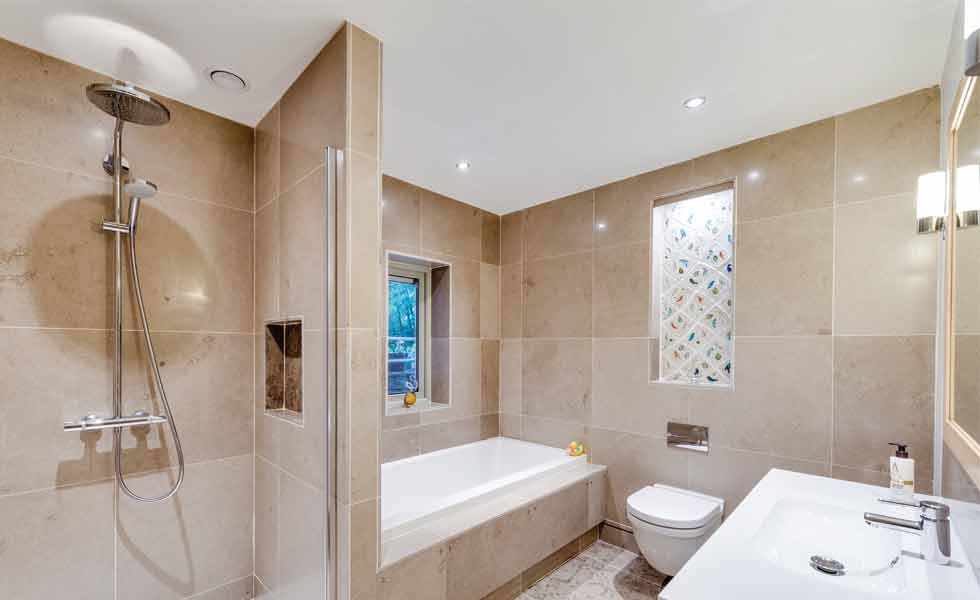En suite bathroom with stone stiles and walk-in shower