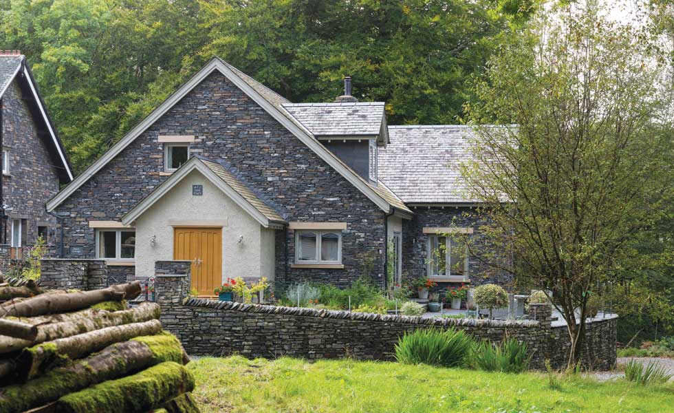 Timber frame self-build with stone cladding and render