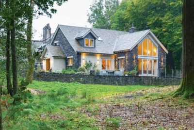 Timber frame self-build with stone and render cladding