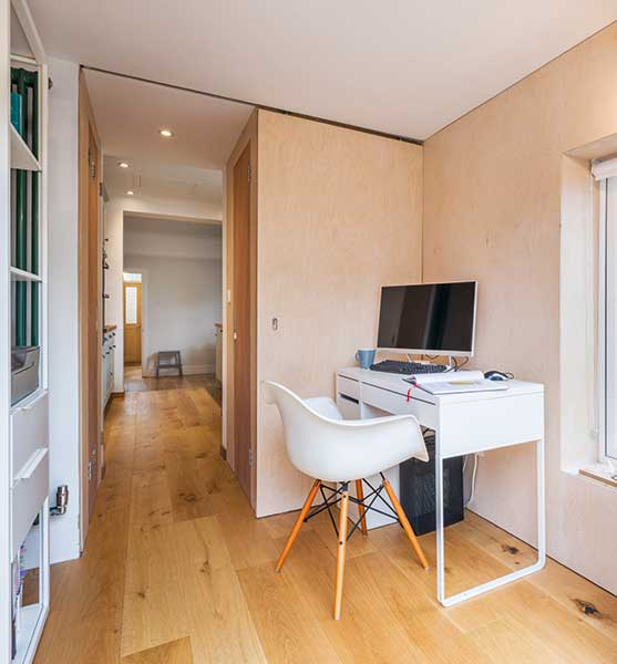 Study with plywood-clad walls