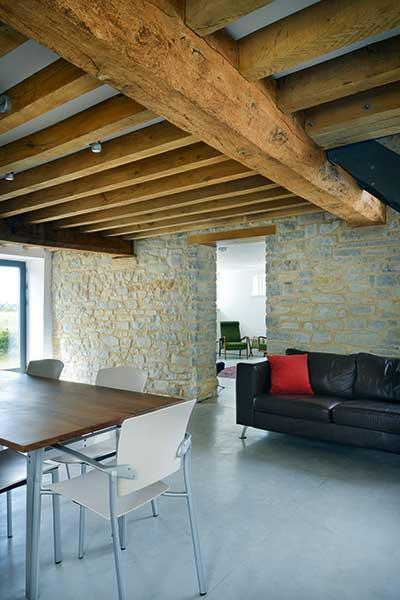 Barn conversion living room with exposed stone walls