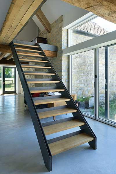 Barn conversion open plan hallway with bi-fold doors