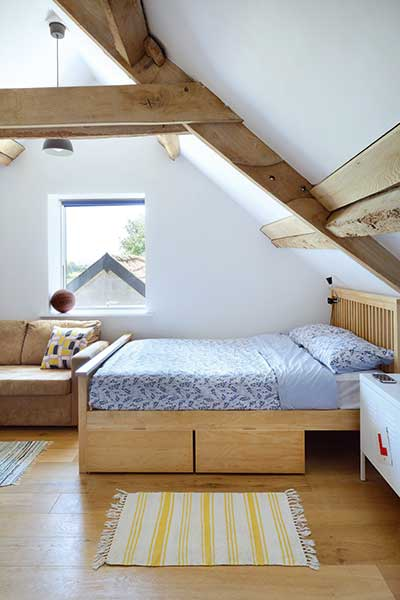 Barn conversion bedroom with exposed beams