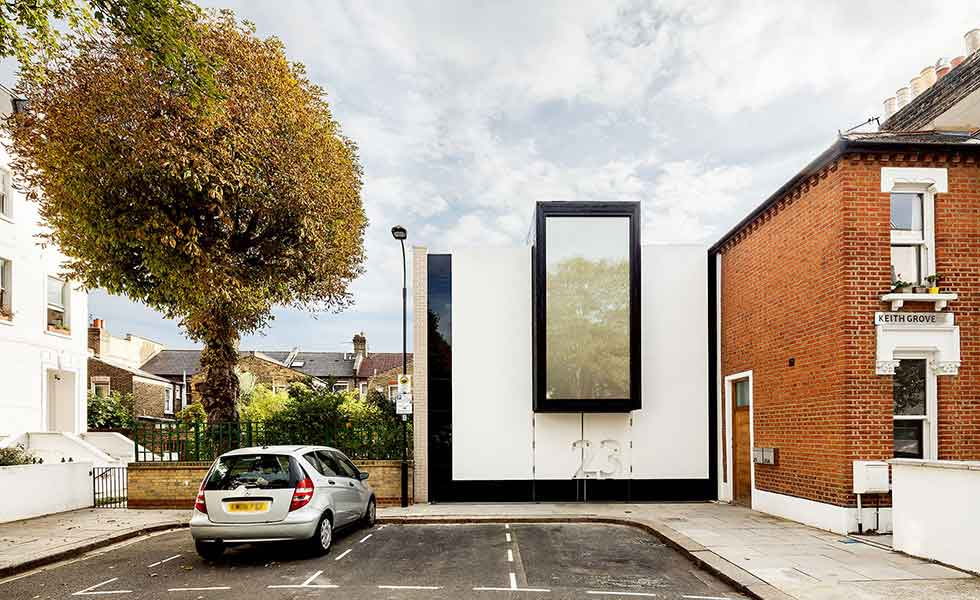 This London home boasts a playful unusual entrance with the door hidden within the facade