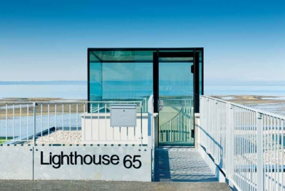 A glass box tops this self build on the coast and provides the entrance leading down into the home