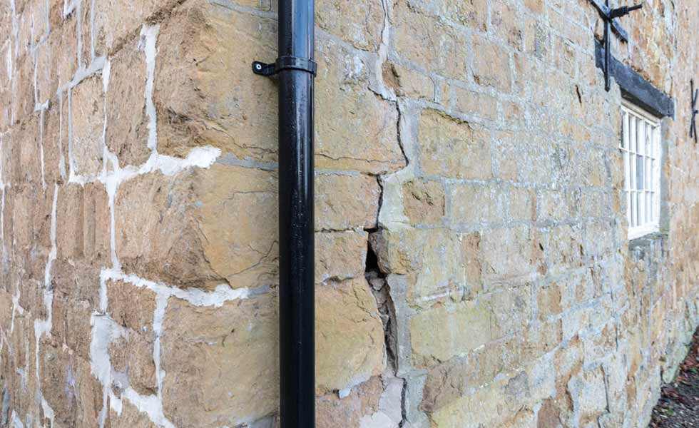 a crack in the external wall requiring structural repairs