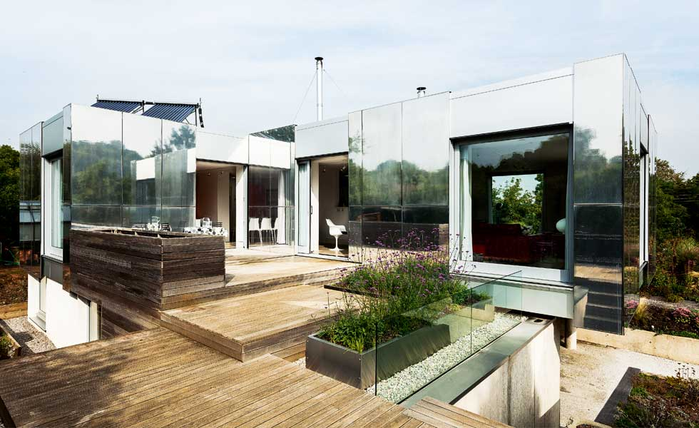 mirrored house with multi-level decked courtyard