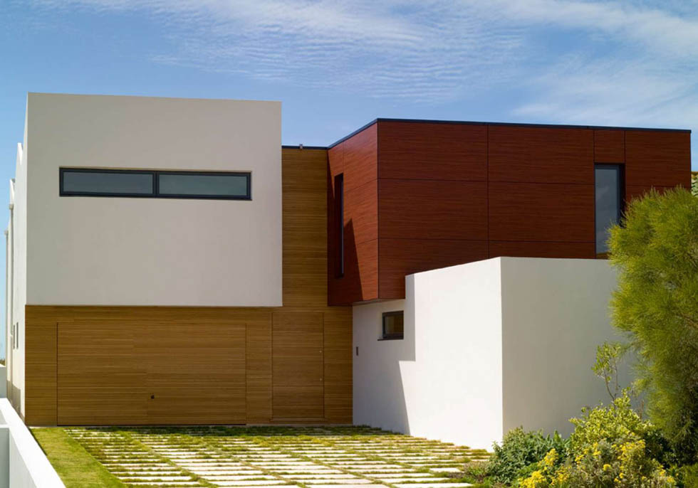 The entrance to this home is hidden within the timber cladding
