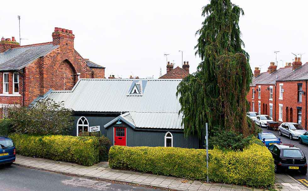 This tin chapel has been converted into a family home, and the tin roof reinstated