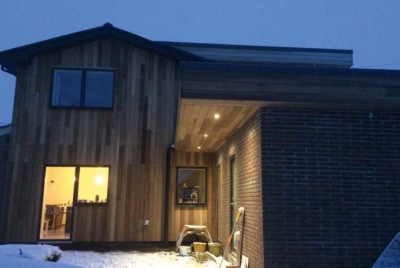 external shot of timber clad remodel project at dusk