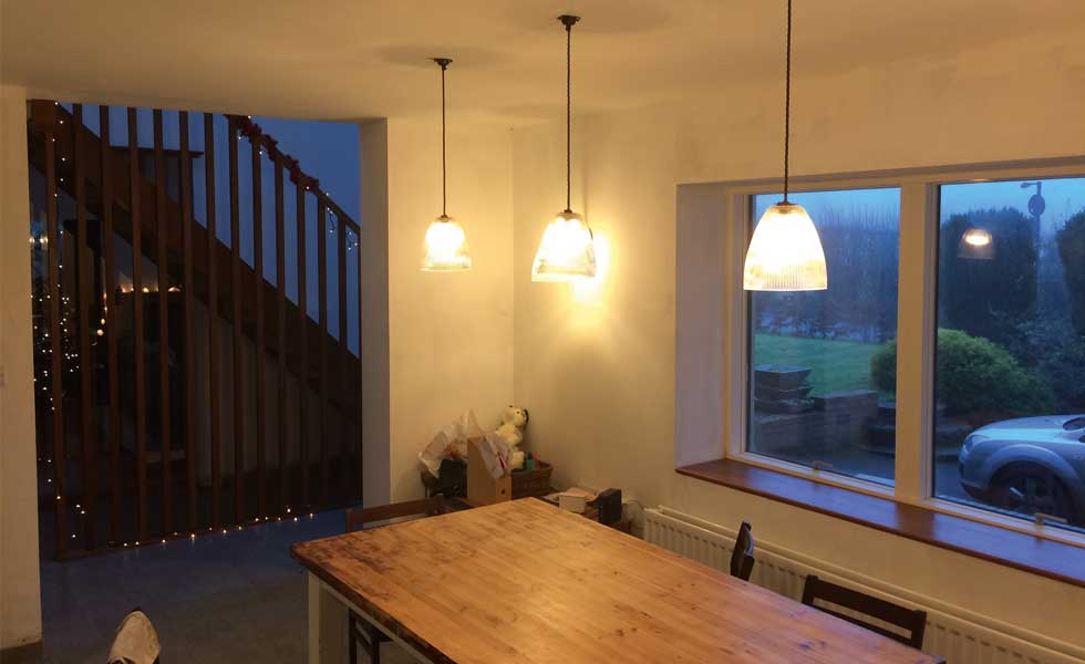 interior shot of view from kitchen to stairs and balustrading with pendant lights