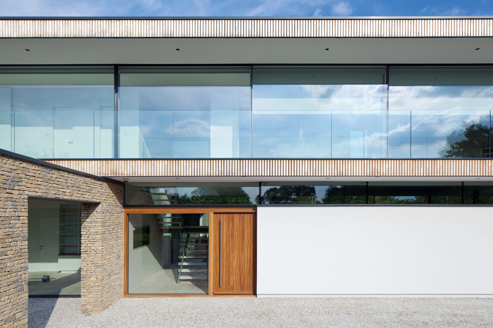 Incorporating clerestory glazing into a home can bring in light as well as allow the roof to appear as if it's floating