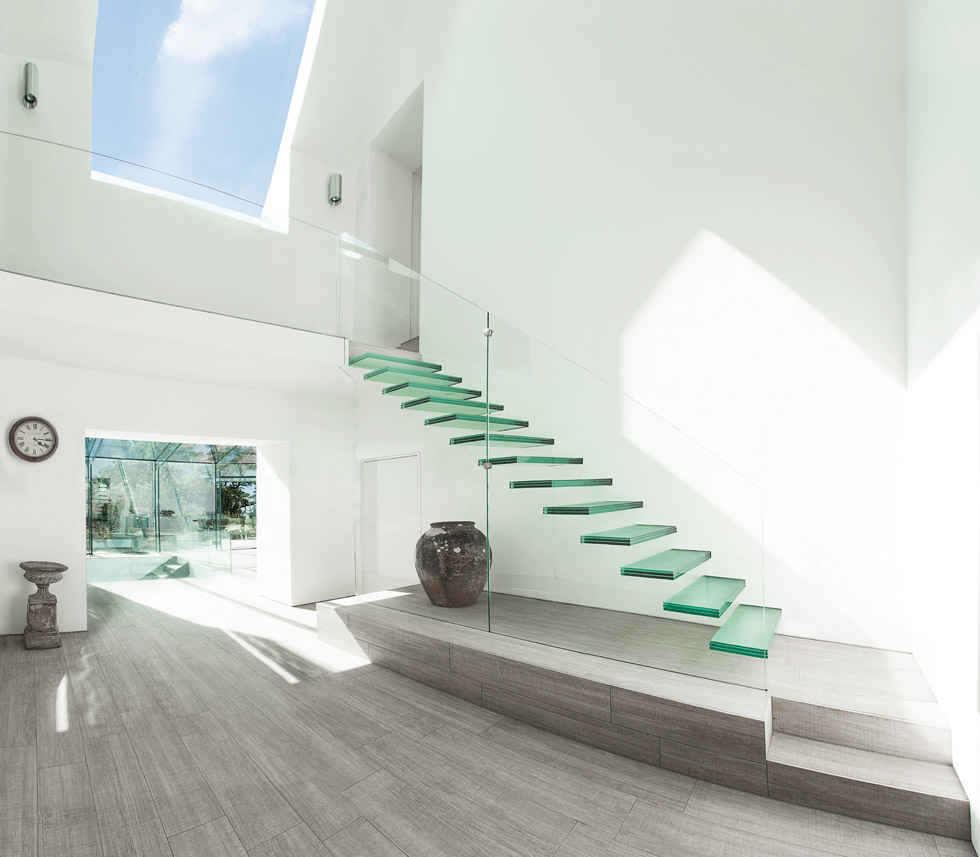Consider using glazing for unusual elements, like stairs, to make a real style statement