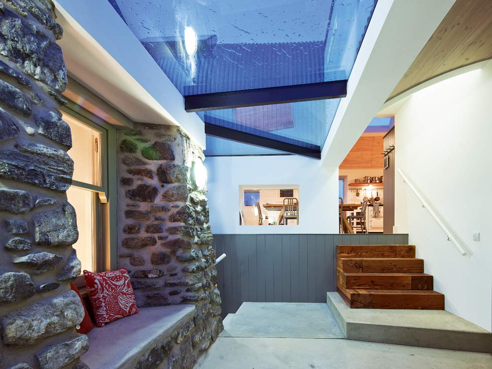 Internal glazing in this home allow glimpses into other spaces in the home