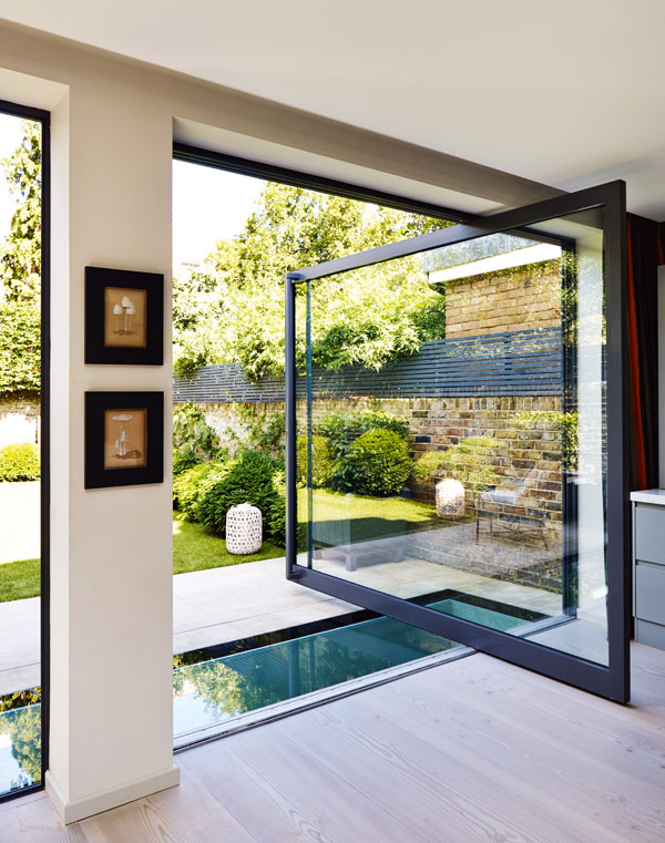 Patio doors which pivot as a means of opening are a fun way of moving from inside to out