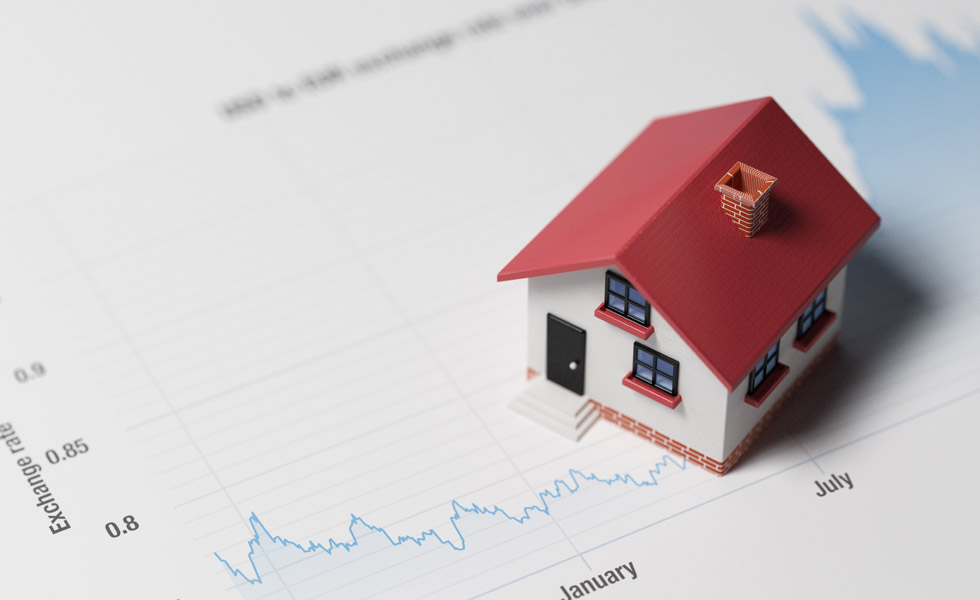 High quality 3d render of a miniature house on a blue financial chart