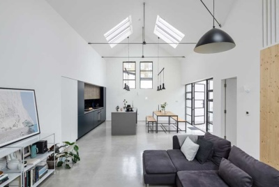 The open plan kitchen living dining space in this conversion project in London oozes minimalist style
