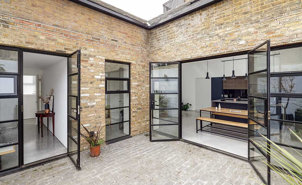 The brick exterior has been restored and a new courtyard created to allow the internal spaces to benefit from the light from the glazed openings