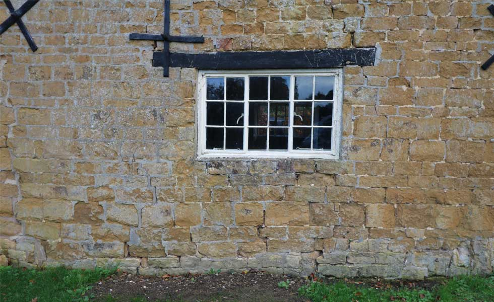 mabels farmhouse wall in need of structural repair