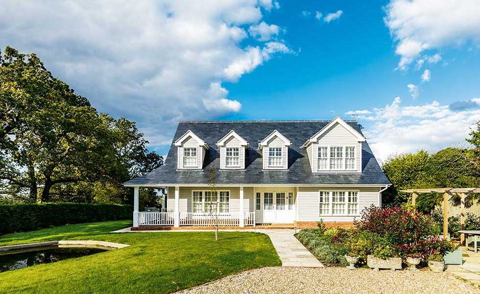 This American-style home oozes traditional charm and character with its dormer windows, low eaves and veradah