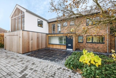 Contemporary self build with render and timber cladding