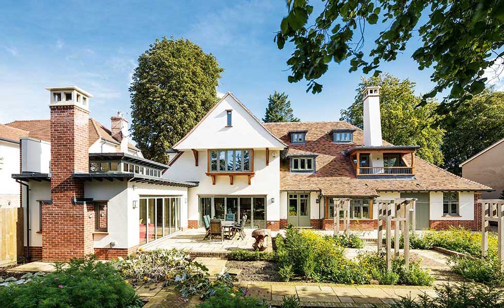 Arts & Crafts style home with steeply pitched roof