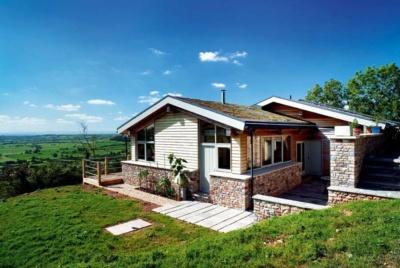 Green roof on charming hillside home