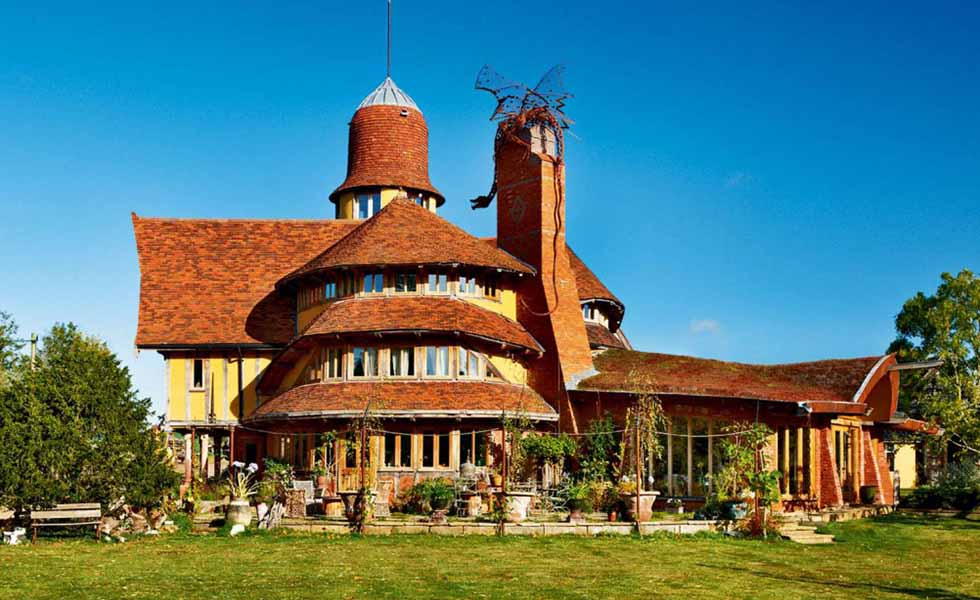 Does it get any more unusual than a dragon on the roof? This inspiring fantasy self build features a dragon sitting atop a chimney