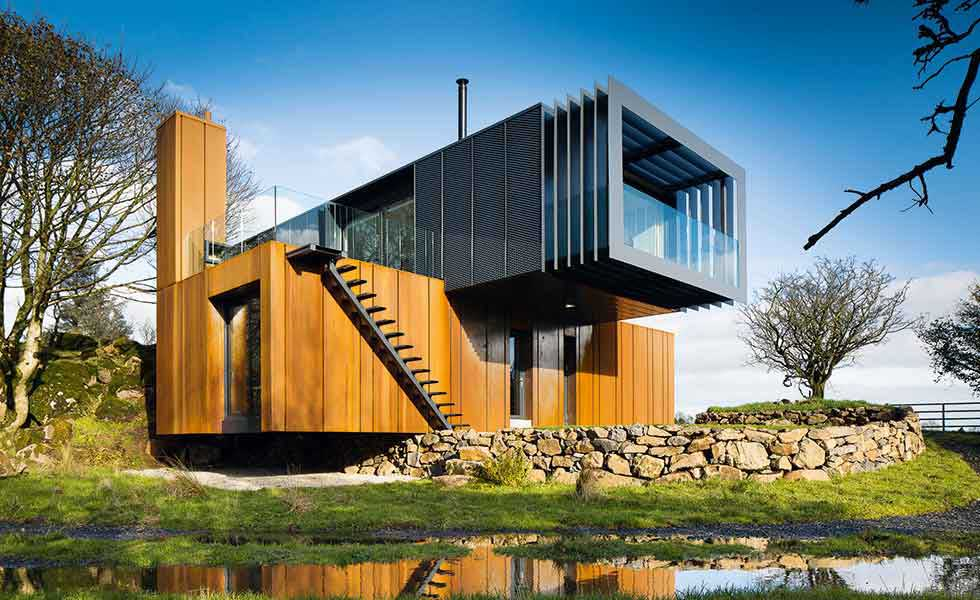 A unique feature of this project in Ireland is its lens style window framing the landscape