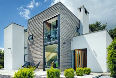 render-and-timber-clad-exterior-of-a-contemporary-self-build