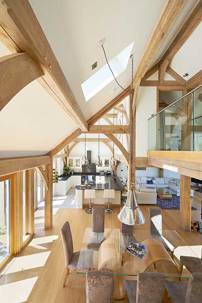 The partially vaulted ceiling in this oak frame home allows for areas of the grond floor to benefit from lofty ceiling heights, while still accommodating for a mezzanine level. A rooflight here also allows light to pour down from above.