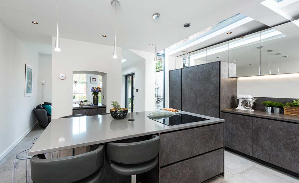 Contemporary kitchen in renovation with island with seating