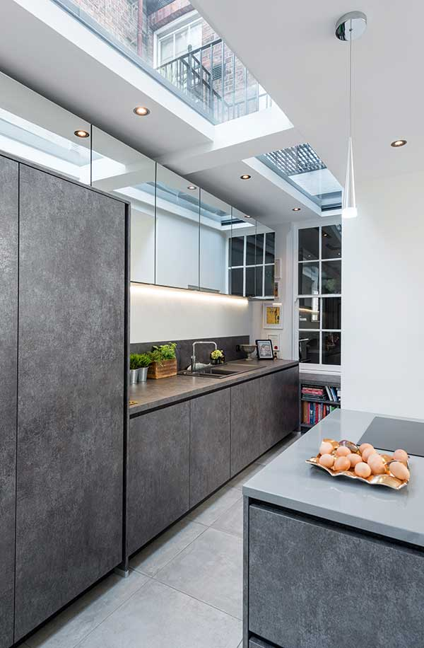 Contemporary kitchen in renovation with rooflight