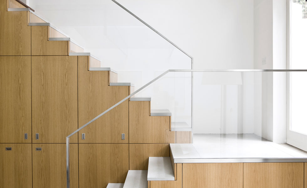 If storage space is at a premium in your home, try incorporating useful cupboards into your staircase design