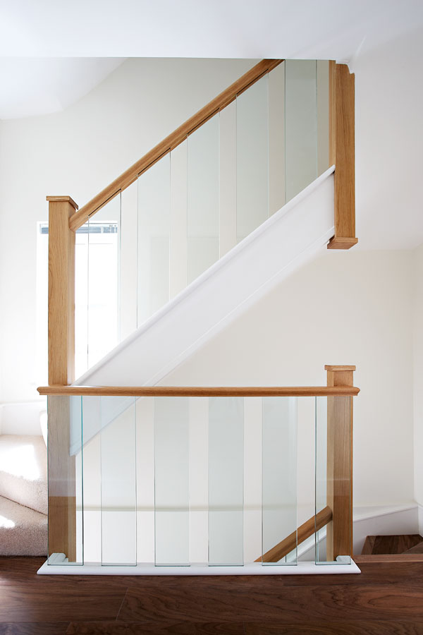 Glass spindles are great for those after a staircase design that is both contemporary and understated