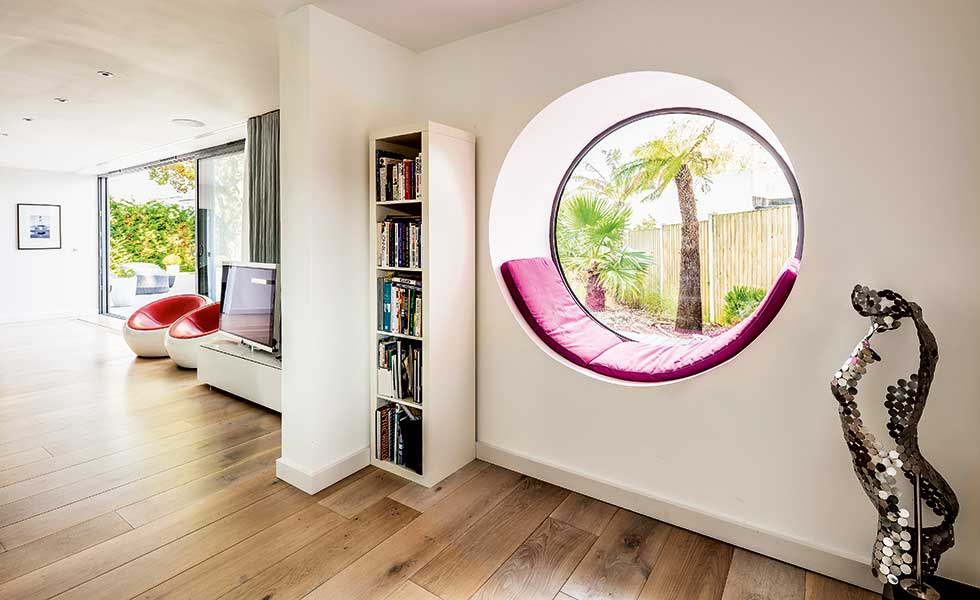 This round window seat is a great talking point and focal feature within this remodel project