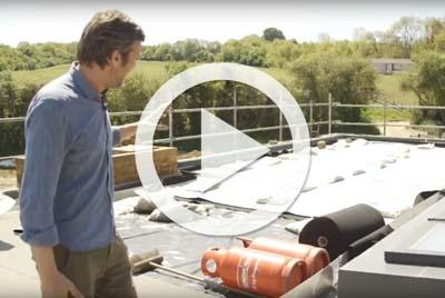Charlie prepares his rooftop garden