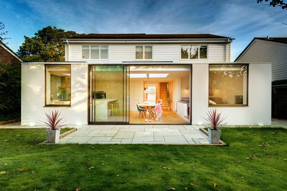 white render and white timber panelling on extended family home