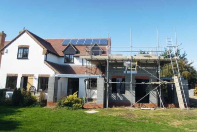 exterior shot of scaffold and extension build progress