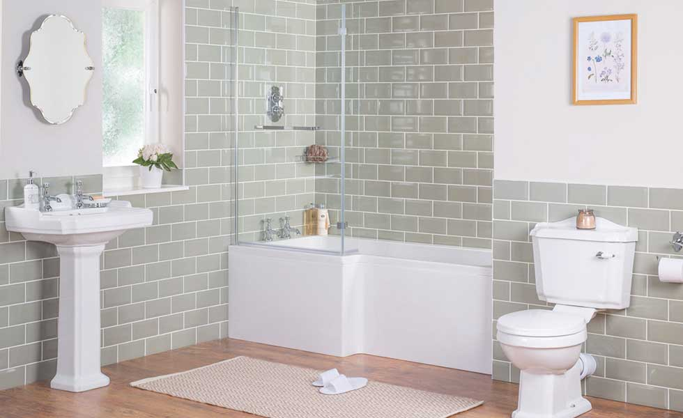 Fully tiled bathroom with shower bath