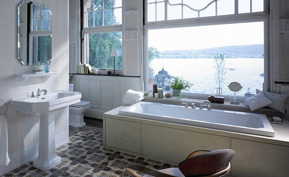 Traditional bathroom suite with built-in bath and sea view