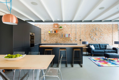 modern kitchen diner with exposed brick wall