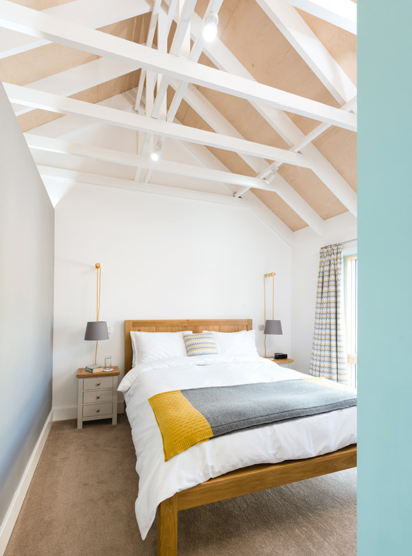 Master bedroom with vaulted ceiling and exposed beams