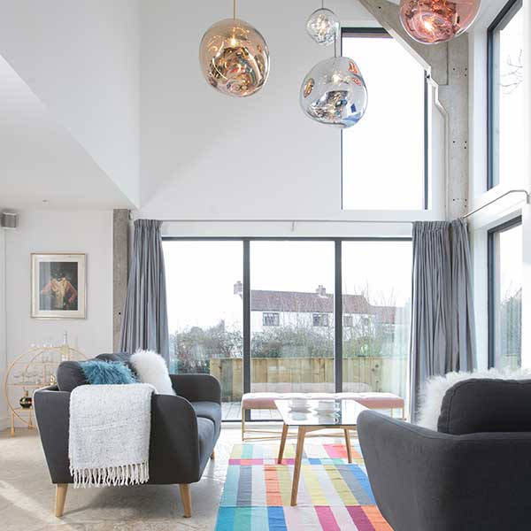 double-height-living-room-with-feature-pendant-lighting