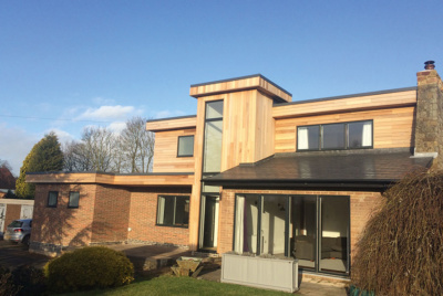Wooden clad exterior of remodelled house