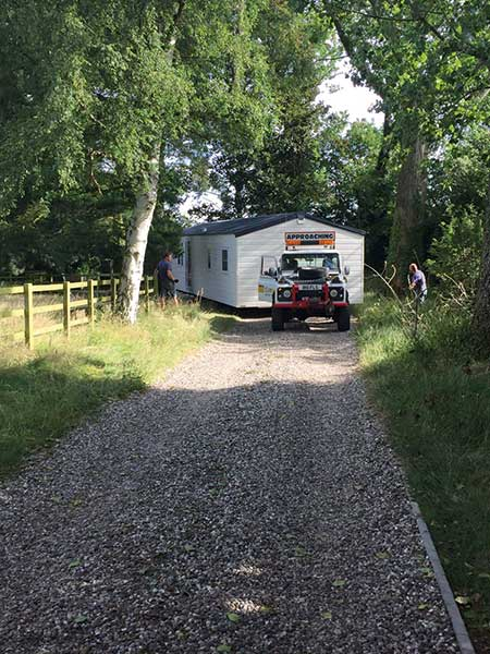 This caravan is being brought to site using a 4x4 car