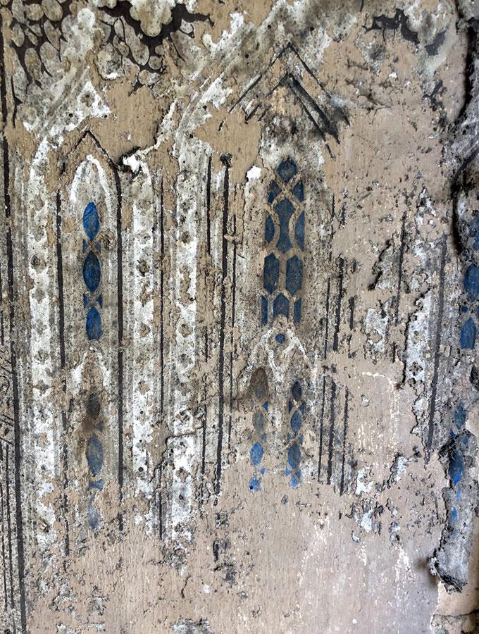 gothic wallpaper on cottage front door