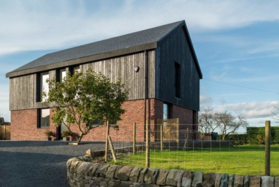 Cheshire self build with brick and charred larch cladding