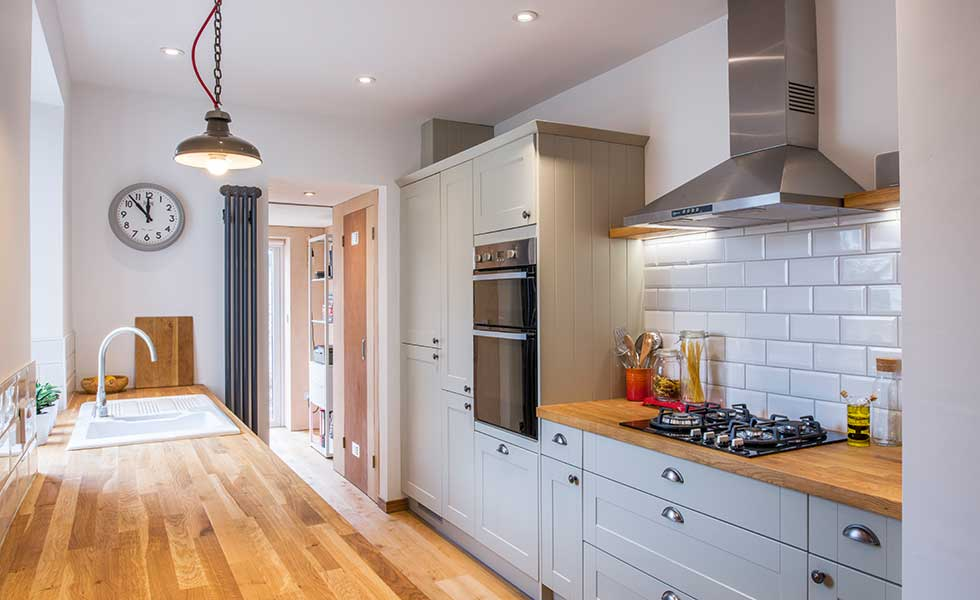 grey shaker style kitchen with wooden worktops