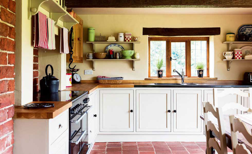 tudor style kitchen red clay tile floor